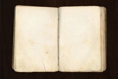 Blank old book. Book with blank paper for inserting your own text, on dark wood table Stock Photography