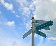 Blank old directional road sign. Post over blue sky royalty free stock photos