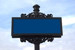 Blank old fashion metal sign. On blue sky Stock Image