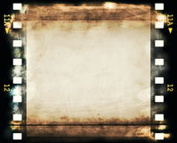 Blank old grunge film strip. Frame background Stock Photos