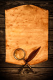 Blank old paper against the background of an aged wood Royalty Free Stock Images