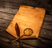 Blank old paper against the background of an aged wood Stock Photography