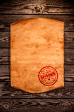 Blank old paper against the background of an aged wood Royalty Free Stock Photos