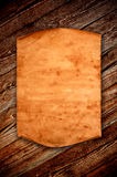 Blank old paper against the background of an aged wood Royalty Free Stock Image