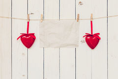 Blank old paper and red heart hanging on wood board background  Stock Photography