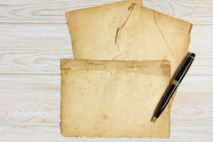 Blank old paper on wood Royalty Free Stock Images