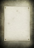 Blank old poster nailed on a grunge wall. Texture royalty free stock photos