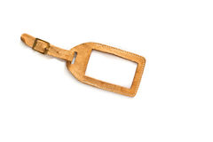 Blank old suitcase tag made of brown leather Stock Images