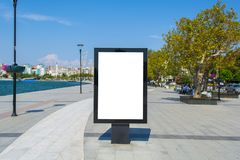 Blank One Vertical Poster Billboard - Including clipping path around blank area. Blank mock up of vertical street poster billboard on city background stock images