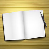 Blank open book with a pen Royalty Free Stock Images
