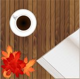 Blank open book ready for your text and cup of coffee are lying on a brown wooden table. royalty free illustration
