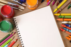 Blank open book, school desk, pencils, crayons, copy space Stock Photo