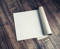Blank open booklet. On vintage wood table background. Responsive design template royalty free stock photos