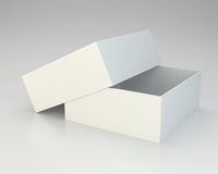 Blank open box on gray background. Royalty Free Stock Image