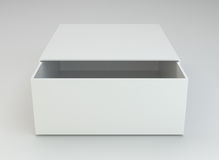 Blank open box on gray background. Stock Photography