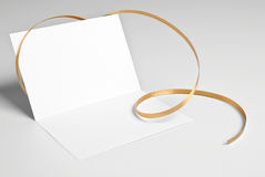 Blank open card with golden ribbon Stock Photo