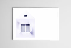 Blank open card with paper house Royalty Free Stock Images