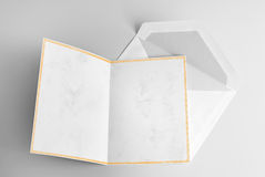 Blank open card with yellow frame and envelope Royalty Free Stock Image