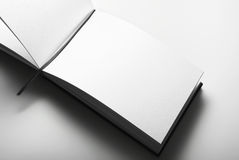 Blank open diary over gray background Royalty Free Stock Image