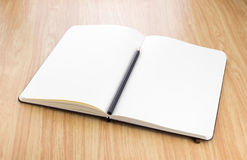 Blank open notebook with black pencil on wood table,Business tem Royalty Free Stock Images