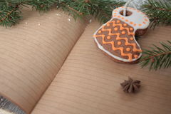 Blank open notebook, Christmas tree, snow, gingerbread, Stock Photo