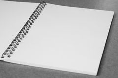 Blank open notebook on desk. Blank notes on the black spiral Royalty Free Stock Images