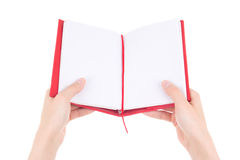 Blank open notebook in female hands isolated on white Royalty Free Stock Photos