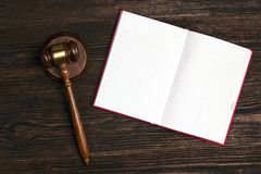 Blank open notebook with judges gavel on wooden table stock photos