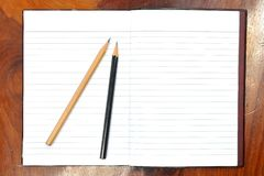 Blank open notebook and pencil Royalty Free Stock Images