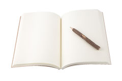 Blank open notebook and pencil on white background. Stock Photos