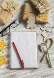 Blank open Notepad, Christmas gifts,  candies Stock Photo