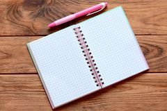 Blank open paper notebook for writing notes, pen on wooden table. Paper notebook worksheet with empty place for text. Closeup Stock Photo