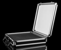 Blank open suitcase close-up on black Stock Images