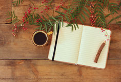 Blank open vintage notebook, old paper and wooden pencil next to cup of coffee over wooden table. ready for mockup Royalty Free Stock Photography