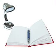 Blank opened book with pen and table lamp stock image