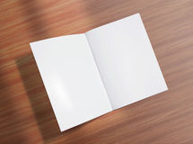 Blank opened brochure on wooden background Royalty Free Stock Photo