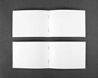 Blank opened magazine  on grey background. Top view Royalty Free Stock Photos