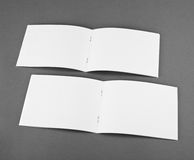 Blank opened magazine  on grey background. Top view Royalty Free Stock Photo