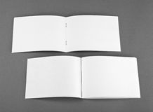 Blank opened magazine  on grey background. Top view Royalty Free Stock Image