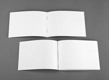Blank opened magazine  on grey background Royalty Free Stock Image