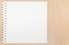 Blank opened notebook on table. Office table with notepad Stock Photos