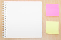 Blank opened notebook on table. Office table with notepad, post. It note, Writing concept. View from above with copy space Stock Images