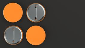 Blank orange badge on black background. Pin button mockup. 3D rendering illustration Stock Photos