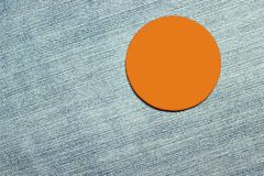 Blank orange badge on trousers material Stock Images