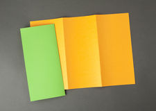 Blank orange and green folding paper flyer Royalty Free Stock Images