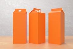 Blank orange milk/juice packagings. Several blank orange carton packagings for milk/juice on light background. Ad concept. Mock up, 3D Rendering Royalty Free Stock Photos