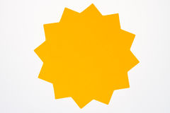 Blank orange star burst isolated on white. Stock Photos
