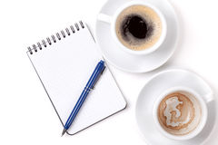 Blank organizer with pen and two coffee cups Royalty Free Stock Images