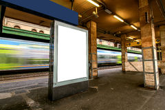 Blank outdoor advertising board at train station. Stock Photos