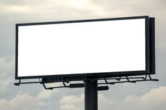 Blank Outdoor Advertsing Billboard Against Cloudy Sky. Blank Outdoor Advertising Billboard Hoarding Against Cloudy Sky, White Copy Space for Mock Up Design or Royalty Free Stock Photos